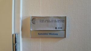 Tabliczka polska agencja żeglugi powietrznej Symulator wieżowy